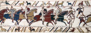 Bayeux_Tapestry_scene51_Battle_of_Hastings_Norman_knights_and_archers-300x109
